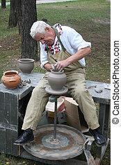 rueda, alfarero, viejo, trabajando, arcilla