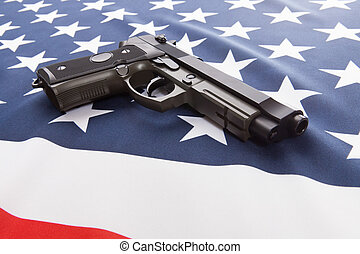 Ruffled national flag with hand gun over it series - USA