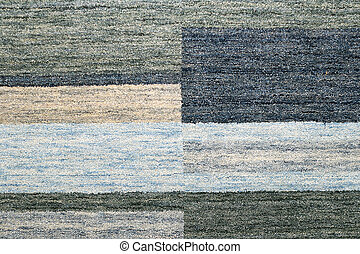 Blue and grey rug made from wool