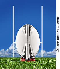 Rugby ball on field with goal posts