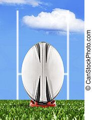 Rugby ball ready to be kicked over the goal posts