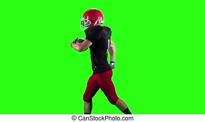 Rugby player running with the ball in his hands. Green screen