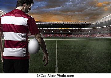 Rugby player in a red uniform. White Background