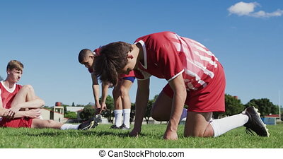 Rugby players preparing for training - Low angle side view ...