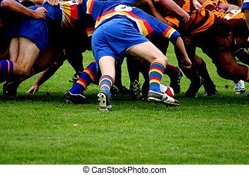 Rugby Scrum - Two opposing rugby teams pack down a scrum as...