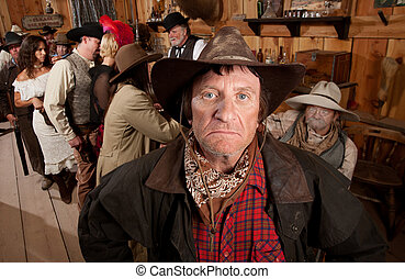 Rugged Cowboy in a Saloon - Closeup of a rugged cowboy...