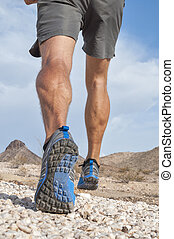 Rugged cross country runner - Closeup of male runner wearing...