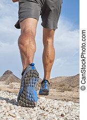 Rugged cross country runner - Closeup of male runner wearing...