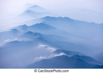 Rugged hills In Morning Mist