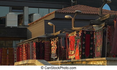 Rugs hanging - Washed rugs drying in the sun and wind in...