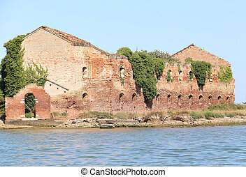 Ruin of a destroyed old brick home in the lagoon