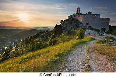 Ruin of castle with sun