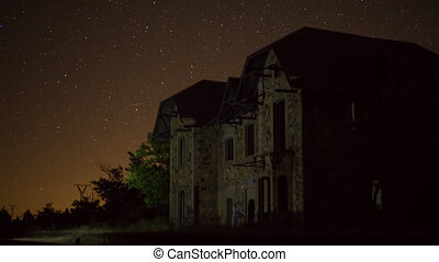 Ruined building night time lapse with plane trails