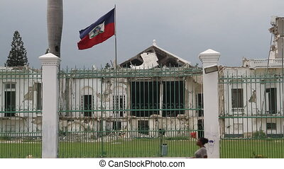 ruined capital building and flag Port-au-Prince Haiti