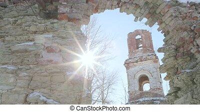 ruined church view through an old window.