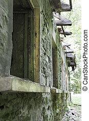 Ruined facade of a forgotten bath center with mineral water basins in Balvanyos, Transylvania, Romania