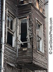 Ruined wooden house - board up shack in slum