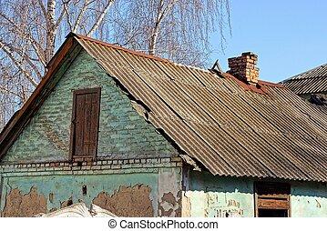 Ruined house with a holey slate roof