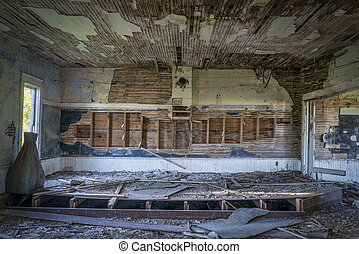 ruined interior of an old abandoned school house