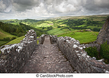 Ruined medieval castle landscape with dramatic sky - ...