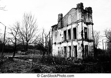 ruined old house in black and white