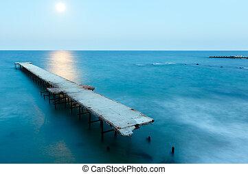 Ruined pier, Moon Path and evening coastline (Bulgaria).