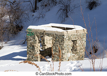 ruined stone house in the mountains