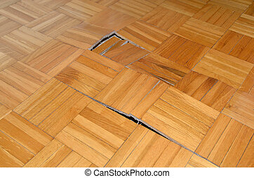 Ruined Wooden Floor - Ruined wooden floor in living room of...