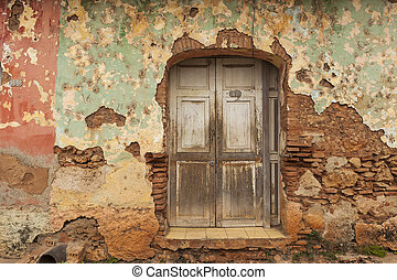 Ruined wooden window on a house in colonial Trinidad, Cuba