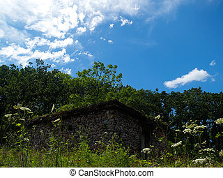 ruins against the blue sky and clouds