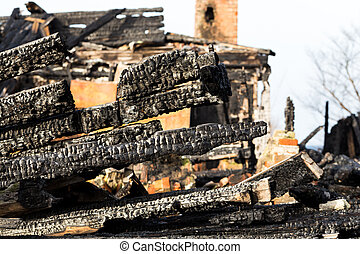 Ruins and remains of a burned down house - The charred ruins...
