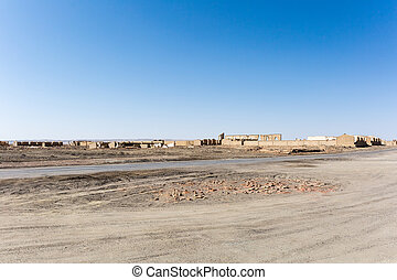 the ruins background of an abandoned town on cold lake oil base, haixi mongolian and tibetan autonomous prefecture, qinghai province, China