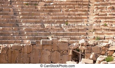 Ruins of an ancient amphitheater in the city of Kas, Turkey. The theater of Antiphelios city in Kas, Turkey.