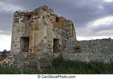 ruins of an ancient Ukrainian castle on the background of stormy sky
