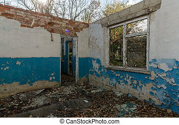 ruins of an old abandoned village house in Ukraine after the war