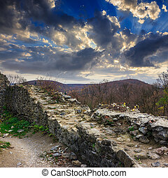 ruins of an old castle in the mountains - Stone wall of an...