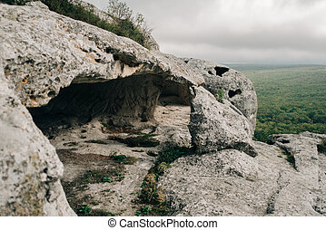 Ruins of ancient cave in a town-fortess Eski-Kermen high in a rock, Crimea. No people.