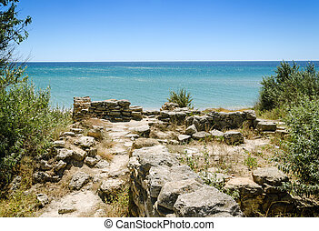 ruins of ancient city on bay