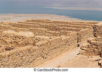 Ruins of ancient Masada fortress in the desert near the Dead Sea
