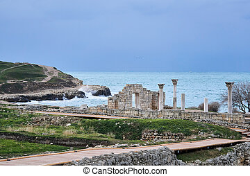 ruins of antique greek basilica with columns on the seashore in Chersonesos