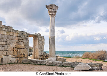 ruins of antique greek temple with column on the seashore