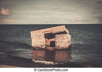 Ruins of artillery coast battery on Saaremaa island , Estonia