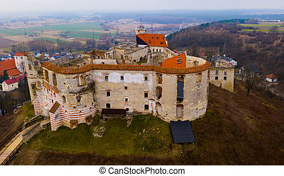 Aerial view of ruins of Renaissance castle on top of hill in Polish village of Janowiec, Lublin Voivodeship