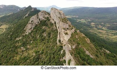 Ruins of Cathar castle of Peyrepertuse perched on rocky ridge. France. High quality 4k footage