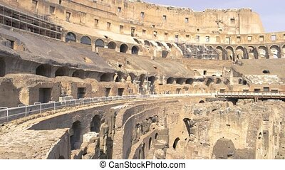 Ruins of Colosseum. Ancient building and people.