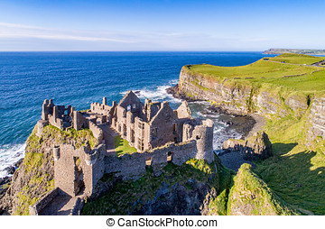 Ruins of Dunluce Castle in Northern Ireland - Ruins of...