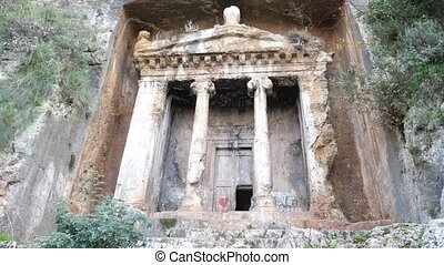 Ruins of impressive rock hewn Tomb of Amyntas at ancient Telmessos in Lycia, currently in Turkish city of Fethiye. High quality 4k footage