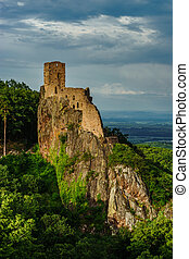 Ruins of medieval castle Girsberg on the top of stone rock
