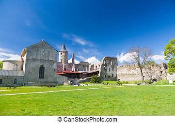 Ruins of medieval Haapsalu Episcopal Castle under blue sky, Estonia