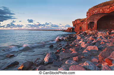 Ruins of old fortress on the Baltic sea shore